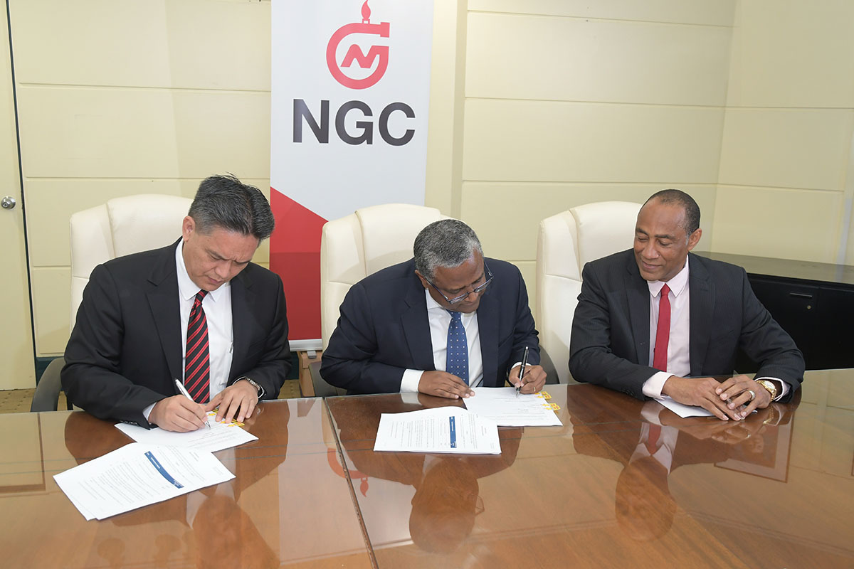 Left to Rright: NGC President, Mark Loquan; ENH Chairman/CEO, Dr. Omar Mithá and NGC Chairman, Gerry C. Brooks signing the Technical Services Agreement at NGC Head Offices on Monday 13th May, 2017